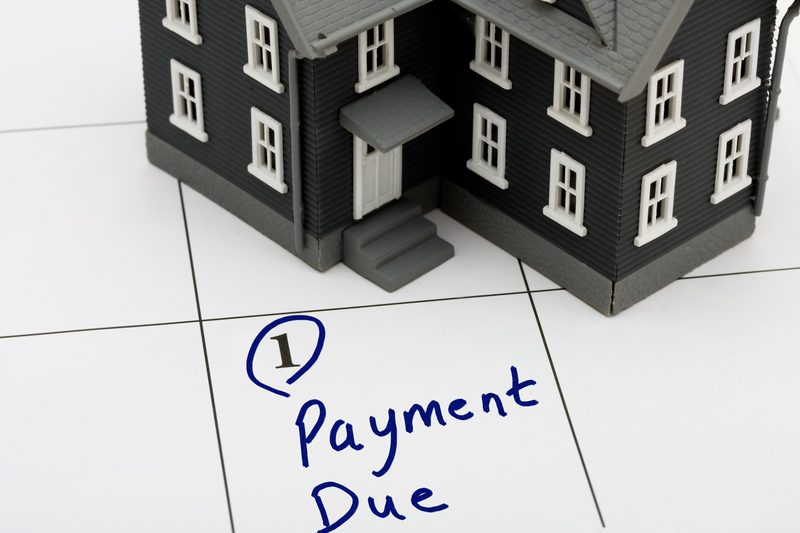 What Happens if a Mortgage Payment is Late? - Source Mortgage - Mortgage Experts Alberta - Featured Image